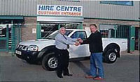 Photo of Tony Newman and Jaime Maskell in front of the new Nissan D22 4x4